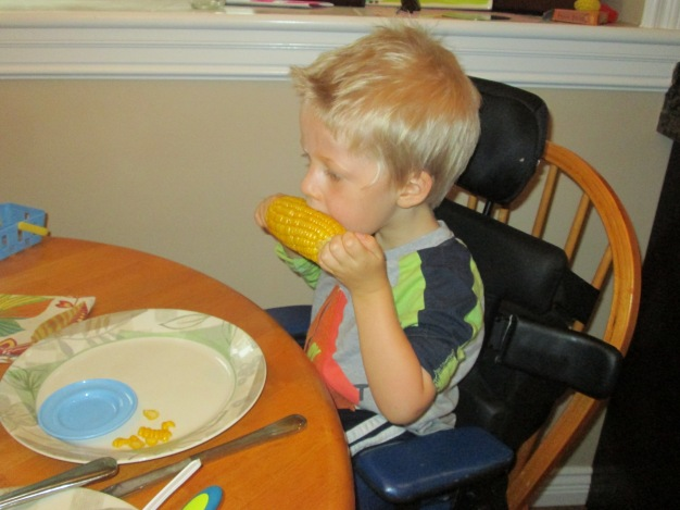 "Corn on the cob! Tasting the ""corn juice""... aka... loads of butter and salt!"